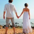 young couple holding hands — Stock Photo #7854893