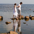 Young romantic pair walks at water — Stock Photo #7856144