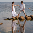 Young romantic pair walks at water — Stock Photo #7856145