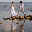 Royalty-Free Stock Photo: Young romantic pair walks at water