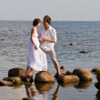 Young romantic pair walks at water — Stock Photo #7856148