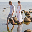 Young romantic pair walks at water - Stockfoto