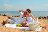 Young romantic couple on the beach — Stock Photo