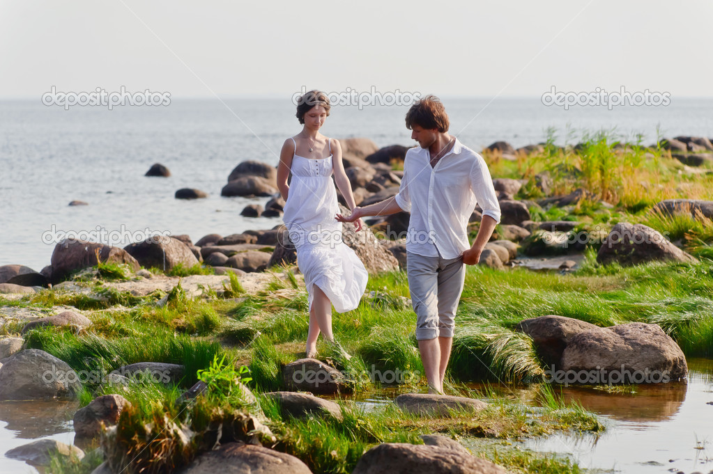 Young romantic pair walks at water  Stock Photo #7856187