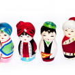Stock Photo: 4 pax four persons cute traditional costume dolls