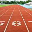 Number five six and seven on the start of a running track — Stock Photo