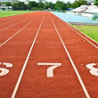 Number six  seven and eight on the start of a running track - Stock Photo