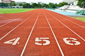 Number four five and six on the start of a running track — Stock Photo