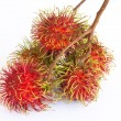 Asian fruit rambutan on the plain background — Stock Photo
