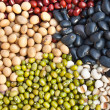 Various colorful dried legumes beans as background - Stock Photo