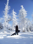 The beautiful girl with snowboard — Stock Photo