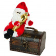 Royalty-Free Stock Photo: Santa klaus sitting on an antiquarian chest