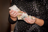 Hands hold money - the Russian roubles — Stock Photo