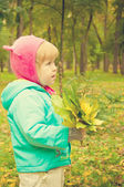 Child walking in autumn park — Stock Photo