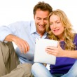 Foto Stock: Couple using digital tablet