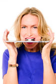 Woman with digital tablet between teeth — Stock Photo