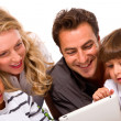 Royalty-Free Stock Photo: Family using digital tablet