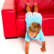 Boy on red sofa — Stock Photo #7485962