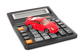Calculator and red toy car — Stock Photo