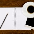 Blank notebook with photo frame and coffee cup — Stock Photo #7625984