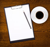 Clipboard with blank page and cup of coffee — Stock Photo