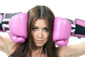 Boxing Woman in pink box gloves ready to attack — Stock Photo