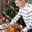 Royalty-Free Stock Photo: Man with Garnished Christmas roasted turkey