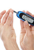 Diabetic patient measuring glucose level blood test — Stok fotoğraf
