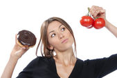 Healthy eating food concept woman donut tomatoes — Stock Photo