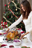 Woman with Garnished Christmas roasted turkey — Stock Photo