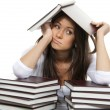 Girl tired of reading books studying school or college — Stockfoto