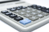 Calculator on white background — Stock Photo