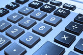 Calculator closeup with cold photo filter. — Stock Photo