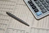 Professional calculator, steel pen and financial newspaper. Busi — Stock Photo