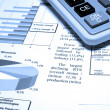Foto Stock: Calculator and finance diagrams.
