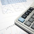 Calculator and financial data with graphs. Business concept. — Stock Photo
