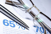 Glasses and pen macro closeup. Business Concept. — Stock Photo