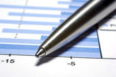 Steel pen macro. Financial concept. — Stock Photo