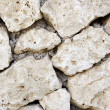 Stockfoto: Close-up wall made of stone. Textured background.