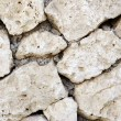 Stock Photo: Close-up wall made of stone. Textured background.