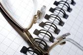 Closeup of eyewear laying on spiral notebook. — Stock Photo