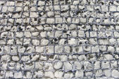 Old road made of stone bricks. Abstract texture background. — Stock Photo