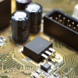Stock Photo: Motherboard's fragment macro photography. Focus on IDE.