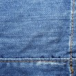 Blue jeans with yellow stitches abstract textle background. - Stock Photo