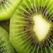 Abstract fresh kiwi macro photo as background. — Stock Photo #7949557