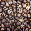 Heap of brown roasted coffee beans closer photo as background or — Stock Photo