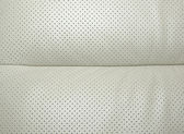 Beige perforated leather - part of modern japanese car interior. — Stock Photo