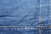 Blue jeans with yellow stitches abstract textle background. — Stock Photo