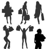 Silhouettes of vector shopaholic girls with bags. More in my gal — Stock Vector