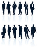 Set of dark blue vector businessman silhouettes with reflections — Stock Vector